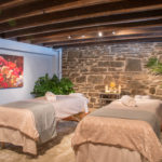 massage room at the spa with stone wall